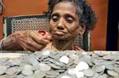 Банк три дня пересчитывал 91 кг мелочи, накопленной нищенкой за 40 лет