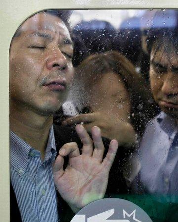 Час пик в токийском метро