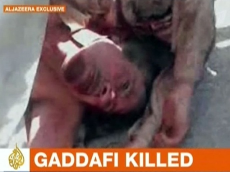 Кадафи убили из за денег