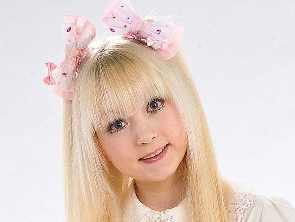 Еще одна девочка-кукла