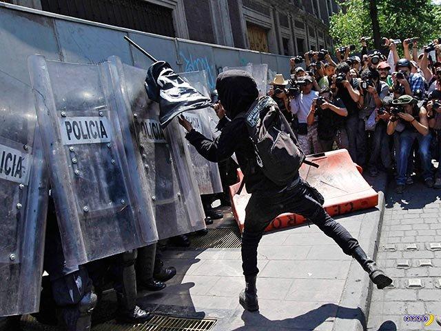 Первомай в мире это драки с полицией и коктейли Молотова