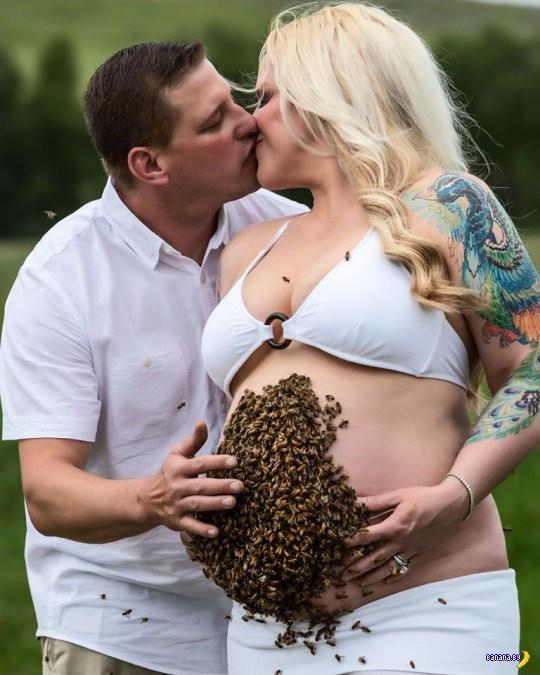 Беременная с роем пчел на животе